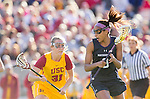 Los Angeles, CA 02/09/13 - Kelsey Dreyer (USC #31) and Taylor Thornton  (Northwestern #9) in action during the Northwestern vs USC NCAA Women Lacrosse game at the Los Angeles Colliseum.