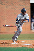 Colin Woody (22) of the UNCG Spartans starts down the first base line against the High Point Panthers at Willard Stadium on February 14, 2015 in High Point, North Carolina.  The Panthers defeated the Spartans 12-2.  (Brian Westerholt/Four Seam Images)