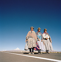 Three ladies in traditional dress with Nevado Sajama volcano in background, Tomarapi, Sajama National Park, Oruro, Bolivia