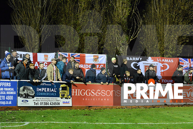 Stourbridge fans and their flags prior to the FA Cup 1st round replay match between Stourbridge and Whitehawk  at the War Memorial Athletic Ground, Stourbridge, England on 14 November 2016. Photo by Garry Griffiths.