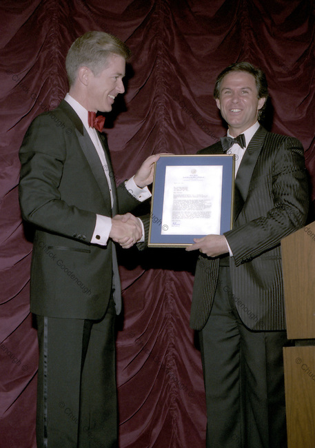 Guess Jeans co-founder Georges Marciano recieves a plaque from former Calfornia Governor Gray Davis - then state controller in 1987