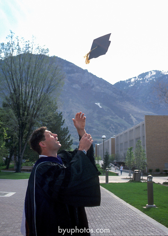 Young Grad 2<br /> <br /> Graduate. Steve Young Graduation photo in cap and gown.<br /> <br /> Photo by Mark Philbrick/BYU<br /> <br /> &copy; BYU PHOTO 2009<br /> All Rights Reserved<br /> photo@byu.edu  (801)422-7322