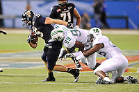 20 December 2011:  FIU tight end Colt Anderson (15) attempts to break away from Marshall defensive lineman Vinny Curry (99) after a reception in the second quarter as the Marshall University Thundering Herd defeated the FIU Golden Panthers, 20-10, to win the Beef 'O'Brady's St. Petersburg Bowl at Tropicana Field in St. Petersburg, Florida.