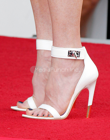 HOLLYWOOD, CA - OCTOBER 03: Close up of Actress Julianne Moore's High Heel Shoe as she is honored with a star on the Hollywood Walk of Fame on October 3, 2013 in Hollywood, California. Credit: Sonboleh/RTN/MediaPunch Inc.