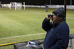 A 'groundhopper'  watching the action through a binocular at Raydale Park, as Gretna take on Dalbeattie Star in a Scottish Lowland League fixture which ended 0-0. The match was one of six arranged by the league and GroundhopUK over the weekend to accommodate groundhoppers, fans who attempt to visit as many football venues as possible. Around 100 fans in two coaches from England participated in the 2016 Lowland League Groundhop and they were joined by other individuals from across the UK which helped boost crowds at the six featured matches.