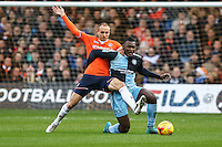 Paul Benson of Luton Town battles with Aaron Pierre of Wycombe Wanderers during the Sky Bet League 2 match between Luton Town and Wycombe Wanderers at Kenilworth Road, Luton, England on 26 December 2015. Photo by David Horn.