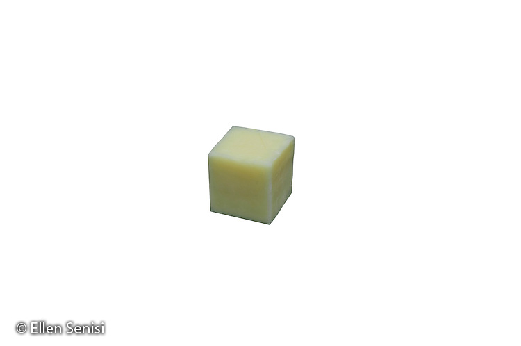 Schenectady, NY.Photograph of a cheese cube on a transparent / white background..© Ellen B. Senisi