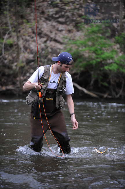 David Patterson catches a small fish in the Dowagiac River in Niles, Michigan...Photo by Matt Cashore/University of Notre Dame