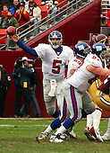 Landover, MD - December8, 2002 -- New York Giant quarterback Kerry Collins (5) passes in first quarter action against the Redskins in Landover, Maryland.  The Giants won the game 27 - 21.<br /> Credit: Ron Sachs / CNP<br /> [NOTE: No New York Metro or other Newspapers within a 75 mile radius of New York City]