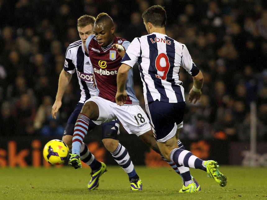 Aston Villa's Yacouba Sylla breaks away from West Bromwich Albion's Shane Long.<br /> <br /> Photo by James Marsh/CameraSport<br /> <br /> Football - Barclays Premiership - West Bromwich Albion v Aston Villa - Monday 25th November 2013 - The Hawthorns - West Bromwich<br /> <br /> &copy; CameraSport - 43 Linden Ave. Countesthorpe. Leicester. England. LE8 5PG - Tel: +44 (0) 116 277 4147 - admin@camerasport.com - www.camerasport.com
