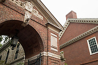 A gated entrance to Harvard Yard and Wigglesworth Hall (right), one of Harvard's freshman dorms, abut Massachusetts Avenue at the edge of Harvard Yard at Harvard University in Cambridge, Massachusetts, USA, on Mon., Oct 15, 2018.