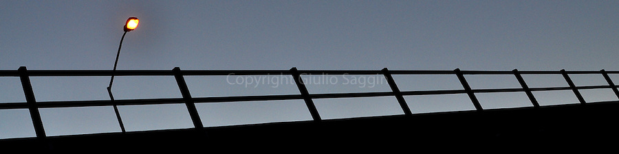 A lone streetlight sits on a bridge in the Brisbane suburb of Gordon Park at dusk one September evening.