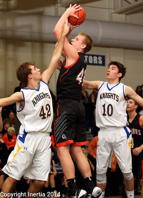 SIOUX FALLS, SD - FEBRUARY 25:  Austin Heins #40 from Washington shoots over Tommy Entwistle #42 and Braxton Elliott #10 from O'Gorman in the second half of their game Tuesday night at O'Gorman. (Photo by Dave Eggen/Inertia)