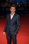 Miles Teller poses on the red carpet as he arrives for the screening of the premiere of 'The November Man' during the 40th Deauville American Film Festival