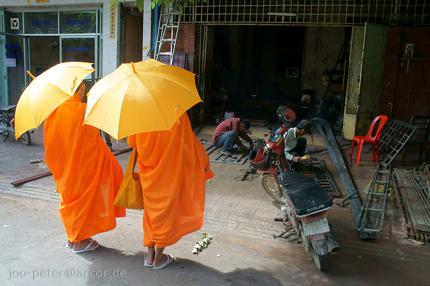 two monk asking for donations in Phnom Penh, Cambodia, August 2011