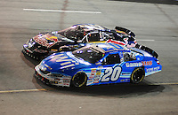 May 1, 2009; Richmond, VA, USA; NASCAR Nationwide Series driver Joey Logano (20) races alongside Scott Speed during the Lipton Tea 250 at the Richmond International Raceway. Mandatory Credit: Mark J. Rebilas-