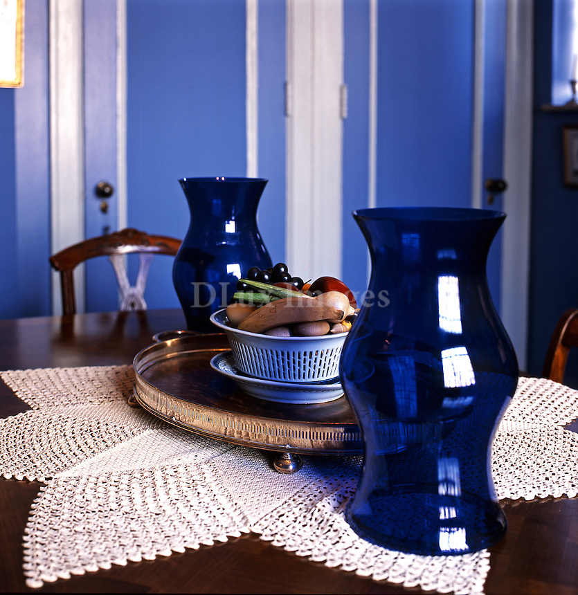 wooden dining table with blue vases
