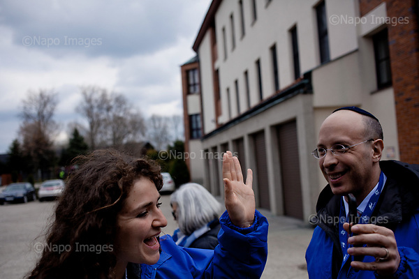 OSWIECIM, POLAND, APRIL 24, 2017:<br /> Elisha Wiesel's friend is talking on the phone to his daughter, who has birthday today, before start of the &quot;March of The Living&quot; an annual march between two camps of the Auschwitz concentration camp.  Elisha Wiesel is a chief technology officer at Goldman Sachs in New York and the only son of Holocaust memoirist Eli Wiesel. After death of his father he has decided to step forward and take a more public role, carrying on his father's work.<br /> (Photo by Piotr Malecki / Napo Images)<br /> ###<br /> OSWIECIM, 24/04/2017:<br /> Elisha Wiesel, syn slawnego Eli Wiesela, bierze udzial w Marszu Zywych w Oswiecimiu. Po smierci ojca Elisha postanowil kontynuoawc jego dzielo.<br /> Fot: Piotr Malecki / Napo Images<br /> <br /> ###ZDJECIE MOZE BYC UZYTE W KONTEKSCIE NIEOBRAZAJACYM OSOB PRZEDSTAWIONYCH NA FOTOGRAFII###
