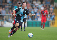 Garry Thompson of Wycombe Wanderers heads forward during the Sky Bet League 2 match between Wycombe Wanderers and York City at Adams Park, High Wycombe, England on 8 August 2015. Photo by Andy Rowland.