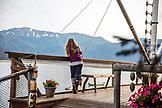 USA, Alaska, Homer, China Poot Bay, Kachemak Bay, individuals hanging out on the dock at Kachemak Bay Wilderness Lodge