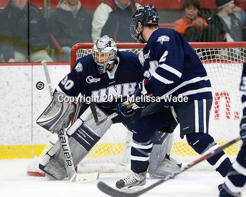 Matt Di Girolamo (UNH - 30) - The Harvard University Crimson defeated the University of New Hampshire Wildcats 7-6 on Tuesday, November 22, 2011, at Bright Hockey Center in Cambridge, Massachusetts.
