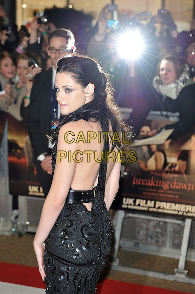 Kristen Stewart.'The Twilight Saga: Breaking Dawn - Part 1' UK film premiere at Westfield Stratford City, London, England..16th November 2011.half length backless looking over shoulder black dress belt sequins sequined flash camera .CAP/MAR.© Martin Harris/Capital Pictures.