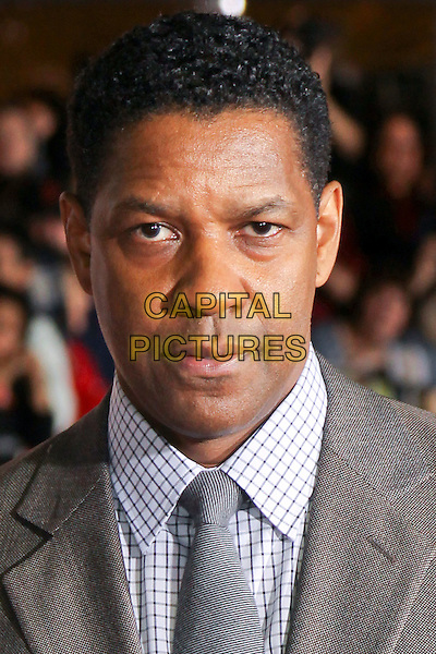 "DENZEL WASHINGTON.Twentieth Century Fox world premiere of Tony Scott's action-thriller, ""Unstoppable,"" at the Regency Village Theater in Westwood. Los Angeles, CA, USA, October 26th, 2010. .portrait headshot white  grey gray suit tie shirt checked check.CAP/CEL.©CelPh/Capital Pictures."
