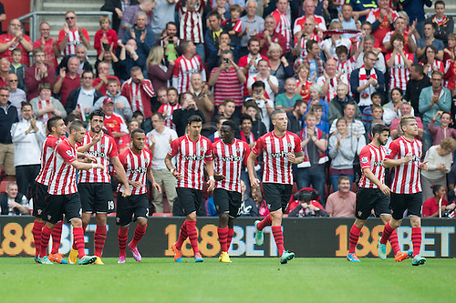 27.09.2014.  Southampton, England. Barclays Premier League. Southampton versus Queens Park Rangers. Graziano Pelle is congratulated by his team after scoring to make it 2-1 to Southampton.