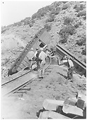 Barranca Hill wreck of July 17, 1929 showing the RPO and combine hanging from the trestle.<br /> D&amp;RGW  Barranca Hill, NM  7/17/1929