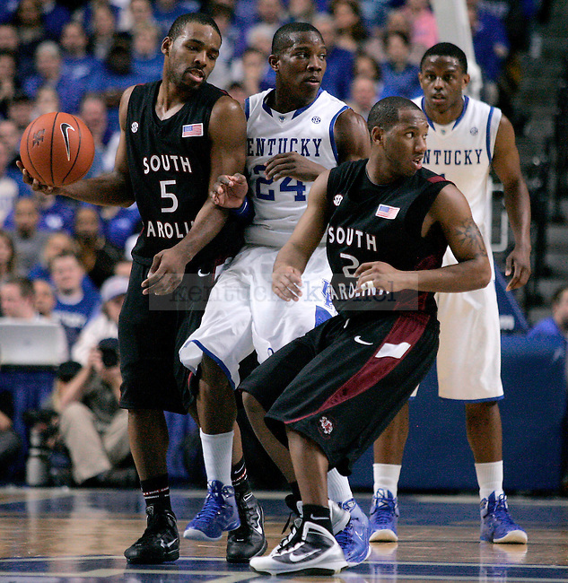 South Carolina and UK players look to a referee to see if a foul was called during the second half of UK's win over the University of South Carolina on Thursday, Feb. 25, 2010 at Rupp Arena. The Cats defeated the Gamecocks 82-61. Photo by Allie Garza | Staff