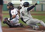 Colorado Springs' Brandon Roberts scores past Reno Aces catcher Konrad Schmidt during a triple-A minor league baseball game between the Reno Aces and the Colorado Springs Sky Sox on Thursday, April 5, 2012, in Reno, Nev. The Aces won their season-opener 5-2. .Photo by Cathleen Allison