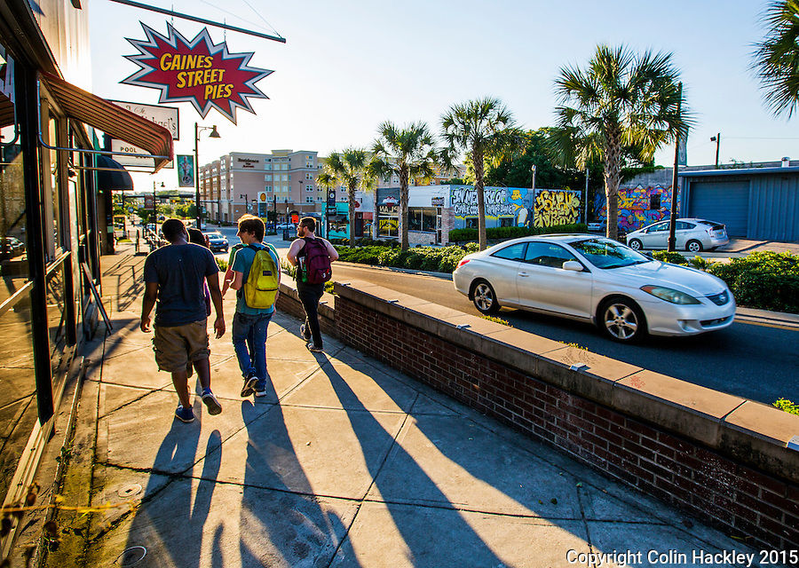 The sun paints long shadows on the sidewalks of Gaines Street in Tallahassee.<br /> <br /> COLIN HACKLEY PHOTO