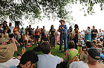 """Pete Seeger, and others conducting a """"River Blessing"""" Ceremony near the Hudson River Shoreline during the Clearwater's Great Hudson River Revival Music & Environmental Festival 2011 at Croton Point Park, Croton-on-Hudson, NY on Saturday June 18, 2011. Photo copyright Jim Peppler/2011."""
