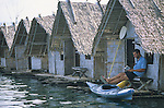 A young man relaxes at the bamboo bungalows in Khao Sok National Park, Thailand.