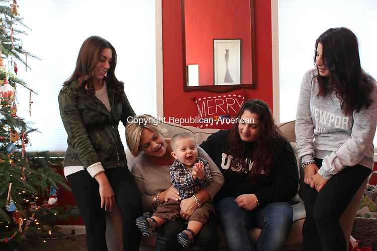 NAUGATUCK, CT-19 December 2013-121913LW03 - 10-month-old James Wood Jr. enjoys the company of, from left, his sister, Ashley Wood, 19, his mother, Lauri Wood, and his sisters Chelsi Wood, 25, and Deanna Wood, 24, in their Naugatuck home.<br /> Laraine Weschler Republican-American