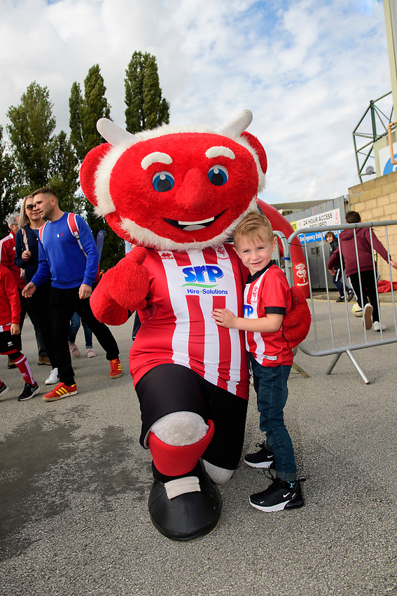 A Lincoln City fan with mascot Poacher the Imp in the fan zone<br /> <br /> Photographer Chris Vaughan/CameraSport<br /> <br /> The EFL Sky Bet League One - Lincoln City v Sunderland - Saturday 5th October 2019 - Sincil Bank - Lincoln<br /> <br /> World Copyright © 2019 CameraSport. All rights reserved. 43 Linden Ave. Countesthorpe. Leicester. England. LE8 5PG - Tel: +44 (0) 116 277 4147 - admin@camerasport.com - www.camerasport.com