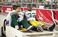 Aug. 28, 2009; Glendale, AZ, USA; Green Bay Packers running back (32) Brandon Jackson is carted off the field after suffering an injury against the Arizona Cardinals during a preseason game at University of Phoenix Stadium. Mandatory Credit: Mark J. Rebilas-