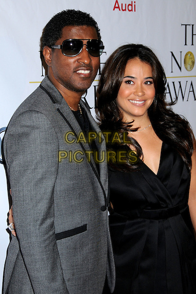 "KENNETH ""BABYFACE"" EDMONDS & GUEST.1st Annual ""Noble Humanitarian Awards"" held at the Beverly Hilton Hotel,  Beverly Hills, California, USA..October 18th, 2009.half length black dress grey gray suit jacket sunglasses shades.CAP/ADM/BP.©Byron Purvis/AdMedia/Capital Pictures."