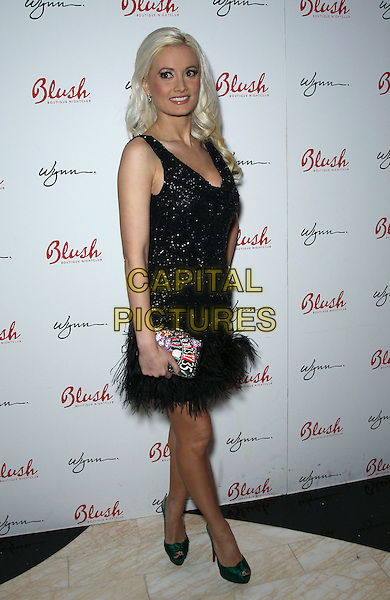 Holly Madison.Holly Madison hosts the 4th Anniversary of Blush Boutique Nightclub inside the Wynn , Las Vegas, NV., USA..September 3rd, 2011.full length black dress sleeveless sparkly  feather green shoes side clutch bag roulette .CAP/ADM/MJT.© MJT/AdMedia/Capital Pictures.