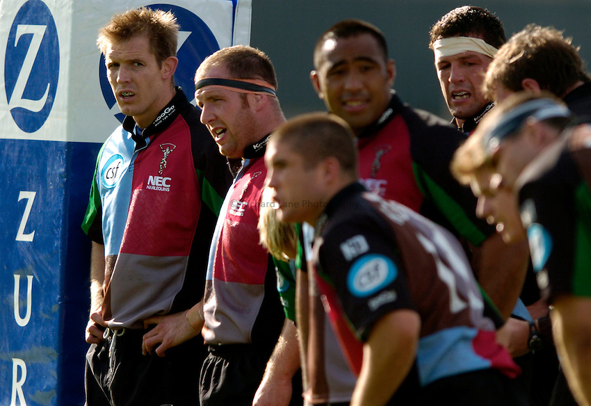 Photo. Richard Lane..Worcester Warriors v NEC Harlequins. Zurich Premiership. 02/10/2004..Dafydd James (lt) faces up with his team mates.