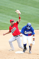 Gabriel Noriega #5 of the High Desert Mavericks tags out Angelo Songco #22 of the Rancho Cucamonga Quakes at second base at The Epicenter in Rancho Cucamonga,California on May 8, 2011. Photo by Larry Goren/Four Seam Images
