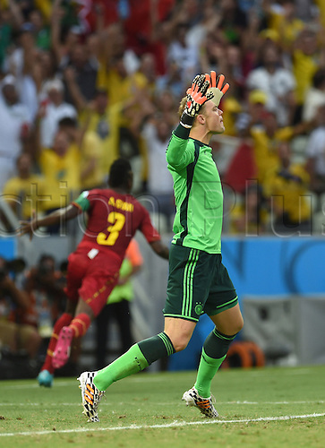 21.06.2014. Fortaleza, Brazil. Germany's goal keeper Manuel Neuer reacts as Asamoah Gyan (L) of Ghana celebrates the goal for 1-2 during the FIFA World Cup 2014 group G preliminary round match between Germany and Ghana at the Estadio Castelao Stadium in Fortaleza, Brazil, 21 June 2014.