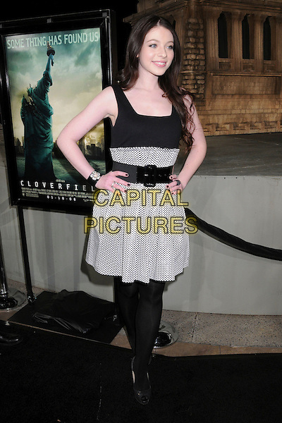 "MICHELLE TRACHTENBERG.""Cloverfield"" Los Angeles Premiere at Paramount Studios, Hollywood, California, USA..January 16th, 2008.full length black white dress belt polka dot hands on hips top skirt.CAP/ADM/BP.©Byron Purvis/AdMedia/Capital Pictures."