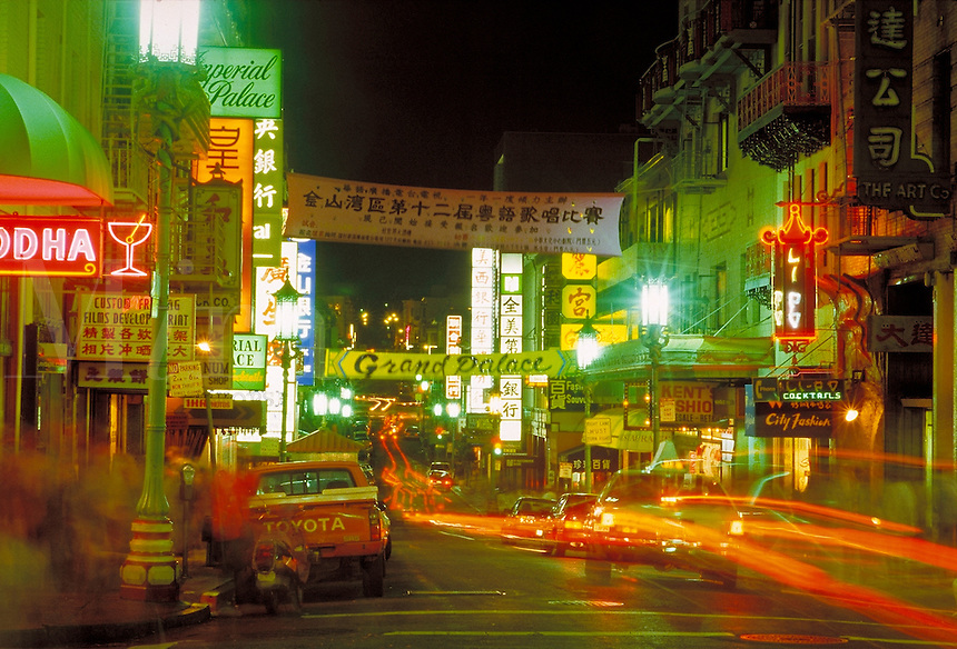 Chinatown; night; banner; sign; neon; traffic. San Francisco California.