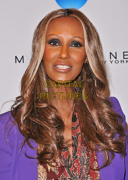 Iman.2011 Lucky Shops VIP Charity Party, New York City, NY, USA..November 4th, 2011.headshot portrait purple blazer jacket scarf red gold print eyeshadow make-up beauty .CAP/ADM/CS.©Christopher Smith/AdMedia/Capital Pictures.