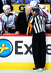 10 February 2010: Washington Capitals' Head Coach Bruce Boudreau listens to referee Eric Furlatt explain a disallowed goal during a game against the Montreal Canadiens at the Bell Centre in Montreal, Quebec, Canada. The Canadiens defeated the Capitals 6-5 in sudden death overtime, ending Washington's team-record winning streak at 14 games. Mandatory Credit: Ed Wolfstein Photo