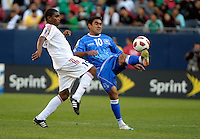 El Salvador's Eliseo Quintanilla plays the ball in front of El Salvador's Francisco Carrazana.  El Salvador defeated Cuba 6-1 at the 2011 CONCACAF Gold Cup at Soldier Field in Chicago, IL on June 12, 2011.