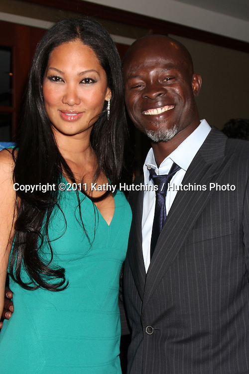 LOS ANGELES - APR 15:  Kimora Lee and Djimon Hounsou attending the 2011 Toyota Grand Prix Charity Ball at Westin Long Beach on April 15, 2011 in Long Beach, CA.