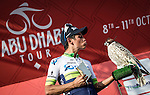 Esteban Chavez (COL) Orica GreenEdge attempts to kiss the podium bird after winning Stage 3, The Al Ain Stage, of the 2015 Abu Dhabi Tour starting from the Al Qattara Souq in Al Ain and running 129 km to the mountain top finish at Jebel Hafeet at 1025 metres, Abu Dhabi. 10th October 2015.<br /> Picture: ANSA/Angelo Carconi | Newsfile