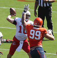 Virginia defensive tackle Brent Urban (99) puts pressure on Ball State quarterback Keith Wenning (10) during the football game Saturday Oct. 5, 2013 at Scott Stadium in Charlottesville, VA. Ball State defeated Virginia 48-27. Photo/The Daily Progress/Andrew Shurtleff